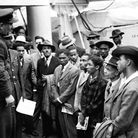 Jamaican immigrants welcomed by RAF officials from the Colonial Office after the ex-troopship HMT 'Empire Windrush' landed...