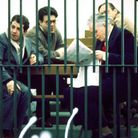 Defendants (Giovanni Falcone, front r) wait behind bars to have their case heard in the Maxi Trial a