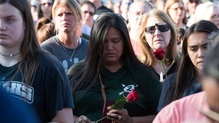 Mourners gather following the shooting that killed 10 at Santa De High School. Picture: PA