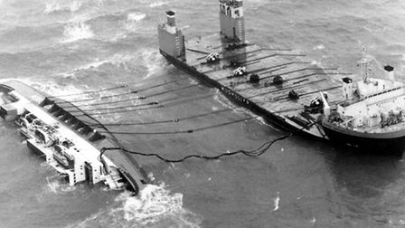 The European Gateway on her side off Felixstowe after the accident in 1982.