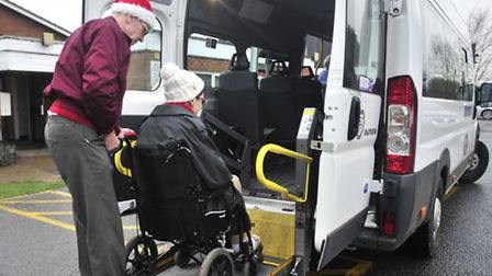 The FACTS dial-a-ride minibus includes a lift at the rear to help peole in wheelchairs get aboard.