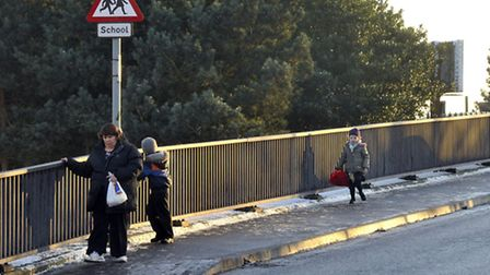 Pedestrians try to avoid slipping over on the Derby Road bridge.