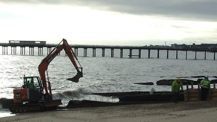 Work taking place on the old concrete groynes on Felixstowe seafront to try to stablise the erosion