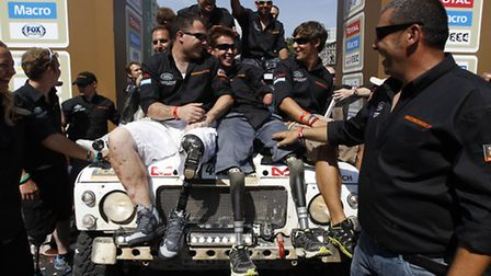 Marine Martyn Willams (sat on the right of the bonnet) celebrates the success of the Race2Recovery t
