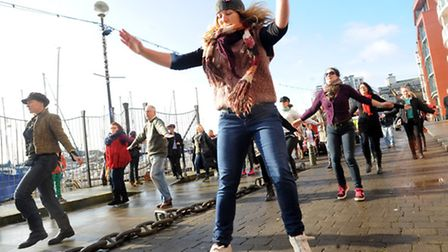 A group of women and some men joined together to perform a dance at the Ipswich waterfront as part o