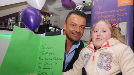 Michael Andre accepts a card from Bethany Woods, 11, on behalf of his brother Peter Andre who had do
