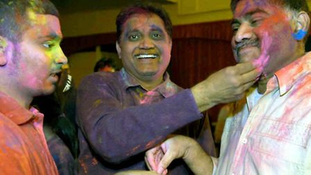 Jay, Anil and Subhash Patel take part in the Holi festival at St Celemets social club back in 2007