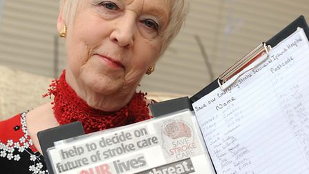 Sylvia Arnold is pictured at her home in Felixstowe with her petition to save the stroke care unit.