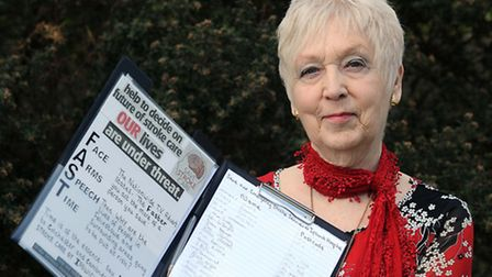 Sylvia Arnold is pictured at her home in Felixstowe with her petition to save emergency stroke care