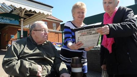 Stroke victim Dudley Knights and Ann Knights sign a Save Our Stroke Care petition from Sylvia Arnold