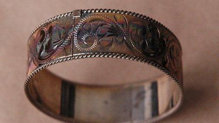 A bracelet was found among a loot of stolen goods