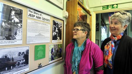 Gayle Crawford, niece of Bill Crump and family friend Laurie Napa look at a display of Jeep