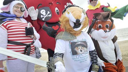 Furry and feathered mascots prepare for the Pirate Walk in Felixstowe on Sunday, 28 July