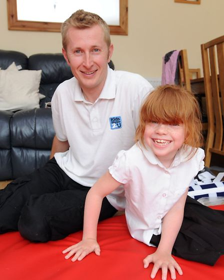 Brooke Lawrance has a physio session with Chris Smith at her home in Ipswich.