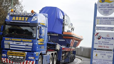 A pilot boat took to the road as Abbey Transport drove the boat with a broken bow to Great Yarmouth