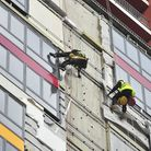 Members of T & I Solutions and Anglo Access Rope Access teams remove damaged materials from The Mill