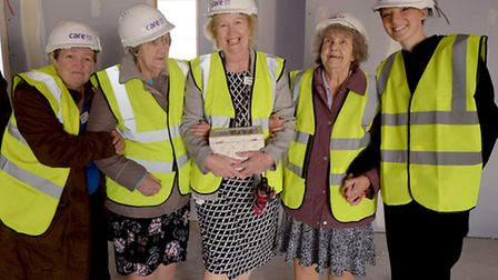 Staff and residents of Hawthorne Drive care home at Asterbury Place.