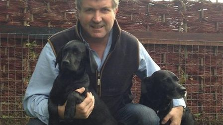 Suffolk Show director Bill Baker with labradors Lottie (left) and Molly