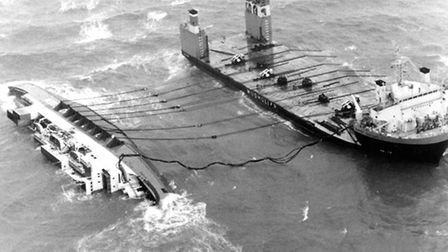 The European Gateway on her side off Felixstowe after the accident in 1982 - preparations underway t