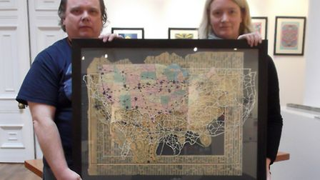 Poet and artist Paul Fisk, from Ipswich, with artist Emma Johnson and her work On The Road featuring