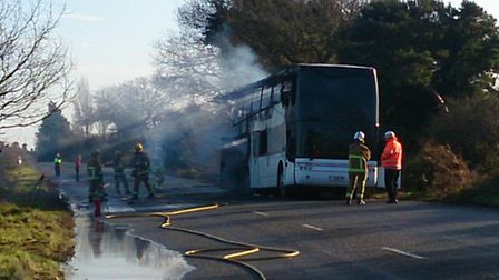 A blaze which broke out in a bus in Suffolk was tackled by firefighters for around an hour. Picture: