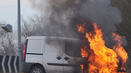 A van on fire at the Asda roundabout in Ipswich.