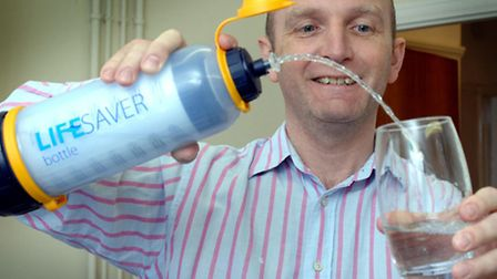 Michael Pritchard of Lifesaver Systems demonstrates the Lifesaver bottle which can make dirty water