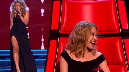 Kylie Minogue listens to Jade Mayjean Peters as she performs during The Voice blind auditions