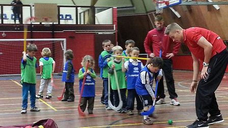 Inspire Suffolk�s professional coaches lead the children through a taster sports challenge at their