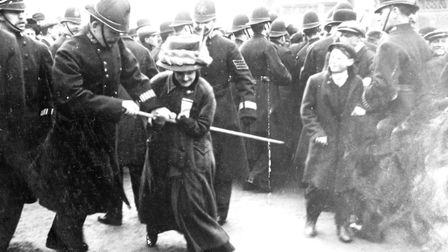 A suffragette struggling with a policeman on 'Black Friday', Westminster, London, 18th November 1910