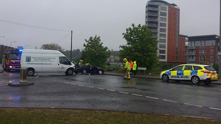 Firefighters worked to rescue a motorist trapped in a blue Audi after it was involved in a collision