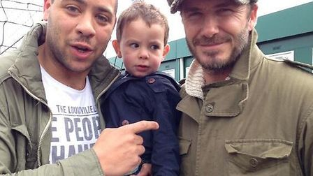 Luke Rutter and his son Blake, two, with David Beckham at Ipswich Town's Playford Road training grou