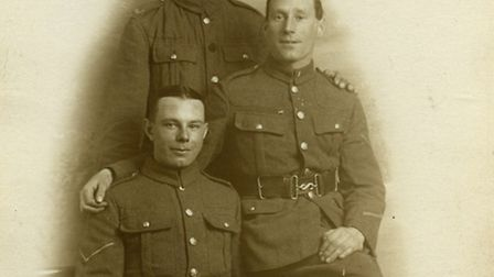 Fred Leggett, seated, with fellow soldiers.