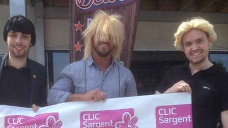 Charlie Manning, centre, and staff members John Cox and Lylle Bonne, in wigs, for a special charity