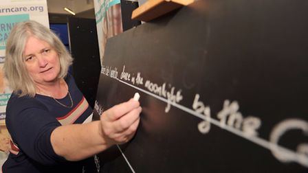 Chief executive of the St Elizabeth Hospice Jane Petit writing what she would like to do before she