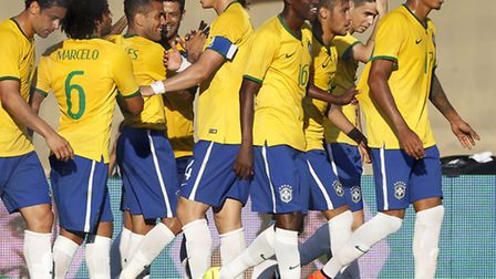 Brazil's Daniel Alves, third from left, celebrates with teammates after scoring in the 4-0 win again