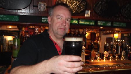 Ady Smith landlord of the Dove Street Inn, raises a glass of Ed Porter, one of the pub's own brewed
