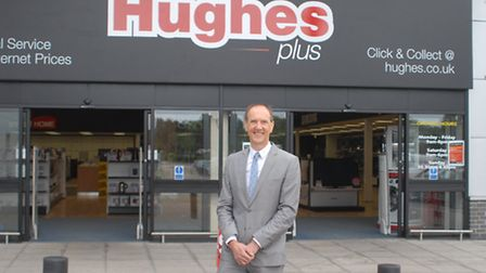 Robert Hughes outside the first new Hughes Plus store.