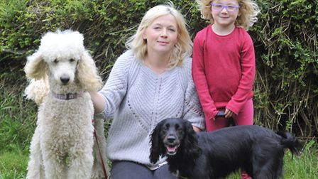 Sally Strutt, with dogs Amber and Jazzy, rescued her four-year-old daughter Olivia and nine dogs fro