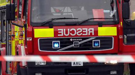Crews battled the flames which had engulfed an upstairs bedroom of a property in Oxford Road.
