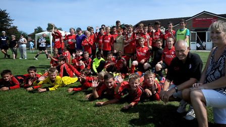 Graham and Linda Hall, parents of Vicky Hall, with players from the Trimley Red Devils football club