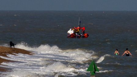 The Harwich lifeboat at the scene of the tragedy while swimmers remain in the sea nearby.