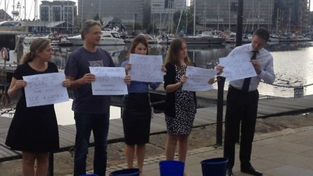Staff from AshtonKCJ take part in the ice bucket challenge outside Isaac's on Ipswich's waterfront