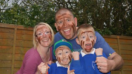 Michelle and Chris Cornish with sons Jamie and Zakk took part in the Insane Terrain Mud Challenge fo