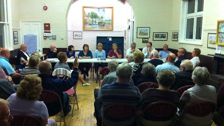 Residents ask questions at an earlier public meeting called to discuss the council homes plan in Gre