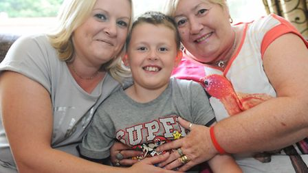 Regan Wood, 9, was responsible for raising the alarm when his grandmother Carol Hunting suffered a d