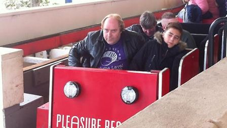 Robert Sycamore, 57, (front left) on the Grand National ride at Blackpool Pleasure Beach with great-