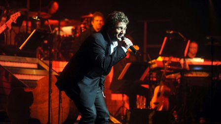 Michael Ball performs on stage at the Ipswich Regent in 2011