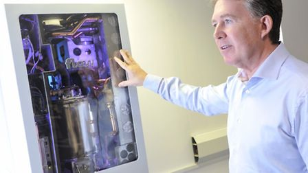 Flow Energy chief executive Tony Stiff stands by the boiler that could revolutionise heating.