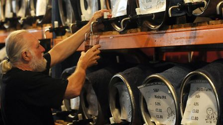 The beer festival at the Museum of East Anglian Life in Stowmarket. Robin Cooper pulls a pint.